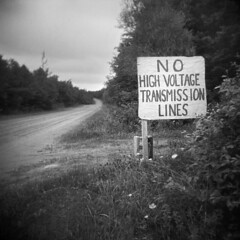 No High Voltage (LowerDarnley) Tags: holga pei princeedwardisland millvale sign electricity protest highvoltage transmissionlines atlanticcanada maritimes road