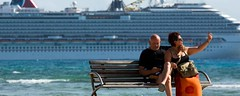 Meet the people whove retired at sea (23hnews) Tags: meetthepeoplewhoveretiredatsea couple seaside sitting bench cruise ship mexico mahahual quinitana roo retired retirees ocean front holiday vacation selfie