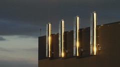 Chimeneas. (Oscar F. Hevia) Tags: sunset chimney espaa hospital reflections atardecer twilight spain steel asturias naturalparadise oviedo ocaso nuevo reflejos chimenea acero asturies ofh uvieu uviu duelos principadodeasturias huca parasonatural uvieo hospialuniversitariocentraldeasturias