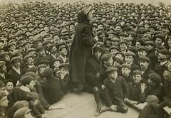 Katherine Douglas Smith speaking to a crowd of men, c.1906-1914.