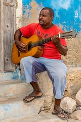 Cape Verdean artist - Boa Vista 2015 (Eric R Porcher) Tags: street portrait people music man guy guitar outdoor saudade streetlife caboverde afrique boavista 2015 morna cesariaevora rabil ef1635mmf28liiusm cadrageenpied canoneos7dmarkii 201511 externalscene