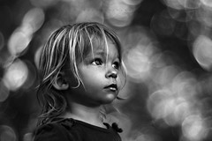 Magic and Wonder (Kapuschinsky) Tags: christmas portrait blackandwhite holiday monochrome childhood wonder lights holidays moody dof child bokeh candid sony magic naturallight telephoto beercan portraiture unposed f4 emotive bnw 70210 vintageglass environmentalportrait watchful spiritoftheseason minoltabeercan milonta sonya700 magicandwonder sonyphotographing