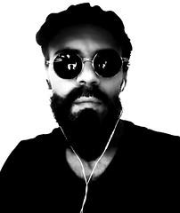"""Webcam"" (Black Portrait). (giannipaoloziliani) Tags: giannipaoloziliani photographer noire dark milan italy milano blackandwhite me justme earphones longbeard beard io retrato web computer selfietime shot myself black selfie webcam selfportrait"