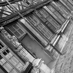(Kelvin P. Coleman) Tags: canon powershot rouen cloister ossuary atre timber frame halftimbered framing pandebois window fentre building architecture tilt pench inclin tilted square bw noiretblanc schwarzweiss blancoynegro outdoor wood wooden bois