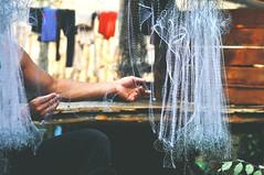 Fishing net (Journal of Journeys) Tags: work fishing net man laos travel nikon photography detail shallow depth