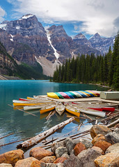 Canoes at Moraine Lake (Rob Kroenert) Tags: moraine lake banff national park canada canoes mountain colorful clouds sky landscape