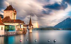 Oberhofen Castle (Jemma (on and off for a while)) Tags: oberhofencastle castle lake switzerland water rainbow reflection mountains cloud storm sky skies longexposure sunset twilight dusk glacial canon canon6d leefilters circularpolarizer lakethun thun 13thcentury bern cantonofbern history historic