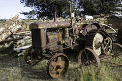 Another abandoned beauty (longreach) Tags: machine tractor abandoned farm rust engine