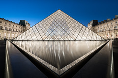 Pyramide du Louvre (McQuaide Photography) Tags: paris france french rpubliquefranaise iledefrance europe sony a7rii ilce7rm2 alpha mirrorless 1635mm sonyzeiss zeiss variotessar fullframe mcquaidephotography adobe photoshop lightroom tripod manfrotto light availablelight bluehour twilight dusk longexposure city capitalcity urban lowlight outdoor outside architecture building wideangle wideanglelens modern modernarchitecture water reflection pyramid geometry shape form geometric symmetry symmetrical louvre musedulouvre courtyard historic museum landmark icon famous travel tourism culture cournapolon court impei glass metal triangle triangular
