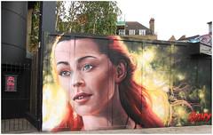 Camden Street Art (Mabacam) Tags: portrait woman streetart london face wall graffiti stencil mural camden wallart urbanart irony freehand aerosolart spraycanart stencilling 2015