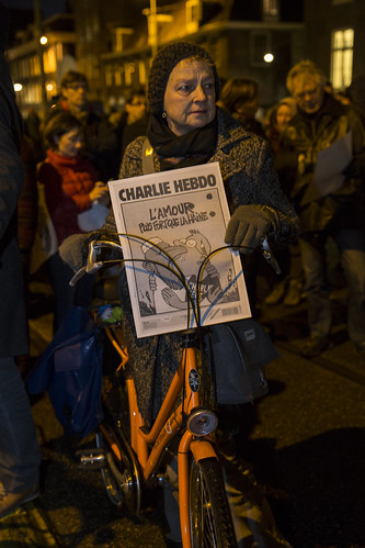 Amsterdam, The Netherlands, January 08 2015: demonstation in solidarity with the attack against Charlie Hebdo in Paris, France on 07 January. A woman…