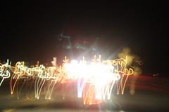 IMG_2564 (gracella2000) Tags: night neon nightlights dancers dancing bright headlights neonlights ballerinas carheadlights safetylights drivingthroughthenight