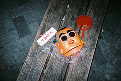 (ourutopia.) Tags: park film sunglasses bench fan fuji mask mju superia buddha religion olympus fujifilm mjuii taoism headgear nezha superia200 mju2