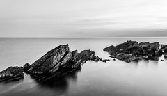 Solid (Nick Panagou) Tags: longexposure light sunset sea sky seascape reflection water contrast landscape blackwhite rocks gulf outdoor dramatic greece waterscape greatphotographers thessaly flickrsbest superphotographer silhouettesshadows bestshotoftheday magnesia canon400d flickrbest bestphotographer shadowssilhouettes spiritofphotography canonefs1855mmf3556isii