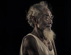 MIA_4562c (yaman ibrahim) Tags: old portrait mist kid smoke palm smoking suluk nikond4 tausug