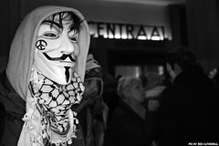Anarchy in your face (Red Cathedral [FB theRealRedCathedral ]) Tags: sonyalpha a77markii a77 mkii eventcoverage alpha sony car sonyslta77ii slt evf translucentmirrortechnology redcathedral streetphotography belgium alittlebitofcommonsenseisagoodthing activism protest anons anonymous millionmaskmarch mmm2016 brussels brussel bruxelles bruxellesmabelle bxllove mask maskedfaces guyfawkes gunpowderplot vforvendetta rememberthefifthofnovember leftwingdemonstration zwartwit noiretblanc noirblanc blackandwhite brusselcentraal gare bruxellescentral station occupy revolt revolution
