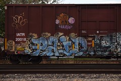 GROM PAID (TheGraffitiHunters) Tags: graffiti graff spray paint street art colorful freight train tracks benching benched grom paid floater boxcar