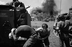 The battle for Saigon 1968 - Photo by Philip Jones Griffiths (manhhai) Tags: amricaindesetatsunisnationalit americannationality barechest battledress bombardement bombardment charmilitaire dedos destruction dtresse distress extrieur exterior fearatmospheresensation fearexpression fume helicopter hlicoptre homme2545ans looksee man25to45years peuratmosphreambiancesensation peurexpression regarder smoke tankmilitaryvehicle tenuedecombat torsenu typehumainblanc viewfromrear whitepeople
