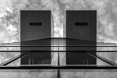 twins (Blende1.8) Tags: cologne kln nrw architecture architektur modern contemporary urban symmetry symmetrie buildings sky huimmel wolken clouds reflection mono monochrome monochrom schwarz weiss gals glass fenster window windows fassade facade carstenheyer nikon d610 afs 2485mm