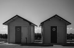 5352 (fishyfish_arcade) Tags: uk greatbritain england blackandwhite bw white black monochrome coast blackwhite seaside nikon photos lincolnshire 1855mm seafront beachhuts eastcoast mablethorpe d3200