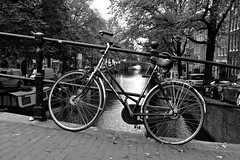 Roll and float (Gareth Priest) Tags: life street city trees houses light urban bw inspiration holland art amsterdam bike dark landscape boat town canal nikon europe experimental mood transport perspective creative highcontrast innercity moment capture d7200