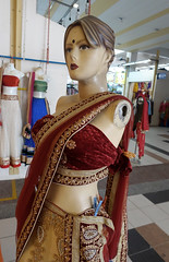 Venus de Milo in a Sari (cowyeow) Tags: street city travel woman color mannequin colors girl strange face fashion shop composition asian weird store clothing singapore funny asia pretty dolls display indian creepy odd littleindia armless dummy missingarm