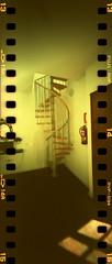 spiral staircase (pho-Tony) Tags: camera film 35mm xpro crossprocessed fuji cross slide panoramic ishootfilm holes pinhole velvia homemade analogue domino 50 expired processed e6 malaga estenopeica sprocket stenope fujivelvia c41 homemadecamera 23mm filmisnotdead pinholecameras tetenal f99 estenopo dominocam dominopinhole