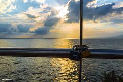 LOCKS (jopas2800) Tags: sunset sea yellow clouds atardecer mar time line amarillo nubes puestadesol tiempo loks candados