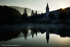 Sunrise at Lake Bohinj (Ian Middleton: Photography) Tags: park travel summer vacation lake holiday mountains alps reflection tourism church beautiful saint sunrise john landscape julian scenery europe european mood moody famous scenic eu tourist clear alpine national valley stunning former popular resorts picturesque region bohinj yugoslavia attraction waterscape triglav slovenian slovene gorenjska janez