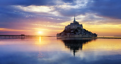 Mont Saint Michel at sunset, France (beatricepreve) Tags: sunset michel mont saint st mount michael church channel mt ocean island destination cathedral historical brittany town france abbey rock european landmark history castle touristic god evening village tourist historic rampart fortress tide normandy famous reflection architecture abey french city postcard sky tourism monastery sea scene michelle bretagne gothic europe atlantic