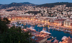 Nice Harbour at Night (Gilbert Kuhnert) Tags: abend avond beleuchtung berg berge bergen blauestunde blauwuur boat boot bot cotedazur darkness donker donkerheid dunkelheid dmmerung evening france frankreich frankrijk hafen harbour haven havenvannice illumination jacht lamp lampe lampen landscape landschaft landschap leuchte light lighting mediterranean middellandsezee mirror mirroring mittelmeer mountains nacht nice niceport night nizza nizzahafen reflectie reflection reflektion scenery schemer schemering schiff schip ship spiegel spiegeling spiegelung transport twilight verlichting wasser water yacht zentrum blauweuurtje bluehour langebelichtingstijd langzeitbelichtung longexposure