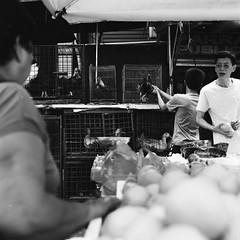Fowl & Fruitful Trade (Mike Enage) Tags: manila quiapo philippines hasselblad 500 500cm 80mm uji neopan acros