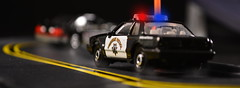 Fox chasing a Fox (FOXHOUNDS_FINEST) Tags: ford police 1993 164 mustang 50 matchbox interceptor mustanggt lx diecast foxbody johnnylightning