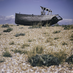 Aground (ShrubMonkey (Julian Heritage)) Tags: history abandoned beach coast boat wooden kent fishing desert decay sony shingle gear coastal shore naturereserve dungeness nautical hull discarded wreck deserted a7 isolated trawler clinker dungenessestate