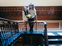 Brittney & Thomas (BurlapZack) Tags: wedding portrait cute stairs groom bride couple downtown married availablelight stairway courthouse bouquet cowboyhat bannister windowlight pack07 dentontx panectorindustries vscofilm olympusomdem5 olympusmzuiko17mmf18