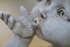 Love (AstridSusann) Tags: makelovenotwar flickrfriday angel stone germany frost kiss