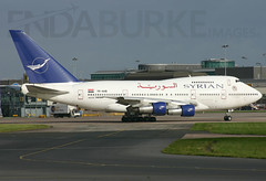 Syrian YK-AHB 31-10-2004 (Enda Burke) Tags: travel england holiday man tower window plane canon manchester evening wings holidays 300d canon300d wing engine cockpit apron landing motionblur engines planes syria pan boeing panning terminal3 departure takeoff runway boeing747 pilot manchestercity pennines controltower manchesterairport syrian winglets taxiing terminal2 terminal1 rvp manc taxiway ringway thomascook tcx egcc 747sp syrianairlines b747sp ykahb thomascookairlines manairport prattandwitney landingear runwayvisitorpark runwayvistitorpark t3carpark manchesterrunwayvisitorpark
