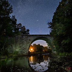 Under the Stone Arch Bridge (Mitymous) Tags: bridge fall2016 longexposure night stars stonebridge zeiss21