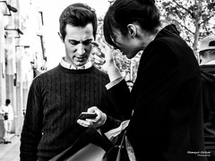 Street - Are you listening to me ? (Franois Escriva) Tags: street streetphotography paris france candid olympus omd sky trees buildings black white bw noir blanc nb pullover sweater man guy woman finger hand phone