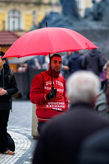 Under the Umbrella (Hukkaneli) Tags: prague city turism xe2 canonfd 135mm umbrella red oldtown