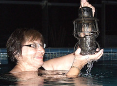 Lantern swim, 2009 (clarkfred33) Tags: pool swimmingpool swim railroadlantern collectorlantern wetwoman wetlook lamp wetadventure wetfun 2009 water wade favorite vintage vintagelantern