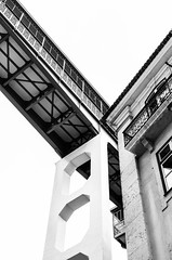 (paulo_m_gonalves) Tags: elevator lisbon portugal ancient antique arch architecture attraction blackandwhite bridge bright building city concrete contrast crossing day enginner facade glass gustaveeiffel heritage iron lines metallic old outdoor santajusta shadow sky stone street texture touristic transportation upview urban vintage wall windows