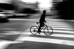 Rush Hour (_Matt_T_) Tags: crosswalk cyclist winter pan street bw smcpda21mmf32al toronto zebra slowshutter