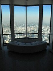 Top of the World (Kre8tyve) Tags: architecture window room sky clouds canon losangeles downtown glass skyscraper tallbuildings skyrise skyhigh seat chair buildings view