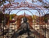 Looking East (oh.suzannah) Tags: statue buddah arches gateway