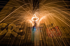 Fire swirl (jarnasen) Tags: d810 nikon nikkor 1635mmf4 tripod longexposure le steelwool fire burning girl grafitti urban night nightphoto trails sweden sverige linkping emma theemmas stergtland city effect street streetphoto wide angle sparkling firerain circle gatufoto copyright jarnasen jrnsen inferno