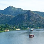 View from Wat Tham Khao Phun over the river Kwae Noi in the later afternoon in Kanchanaburi, Thailand thumbnail