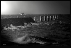 Breakwater1 (agphoto100) Tags: mono waves sea water foam rocks peirs boat rough olympus sz16 photoscape monochrome schorncliffe brisbane