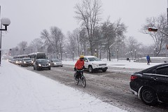 Slippery commute (beyondhue) Tags: bicycle bicyclist rush hour traffic snowing snow winter weather gatineau ottawa beyondhue car road street vehicles ice cold falling