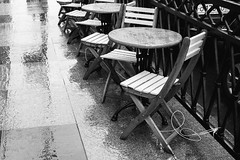 wet chairs (red line highway) Tags: everyday life people motion movement street social documentary city nikon stpetersburg russia   photography blackandwhite monochrome downtown urban 35mm chair chairs wet rain